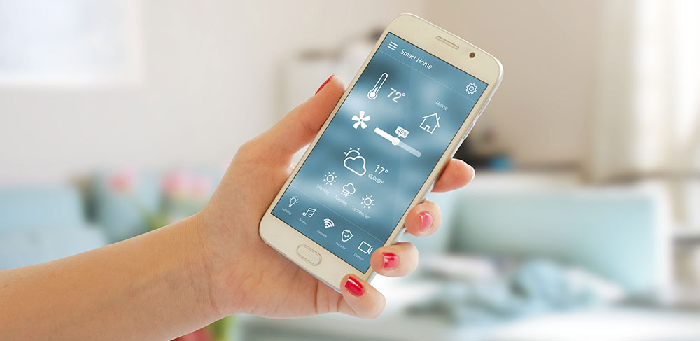 woman using a smart phone to control the thermostat