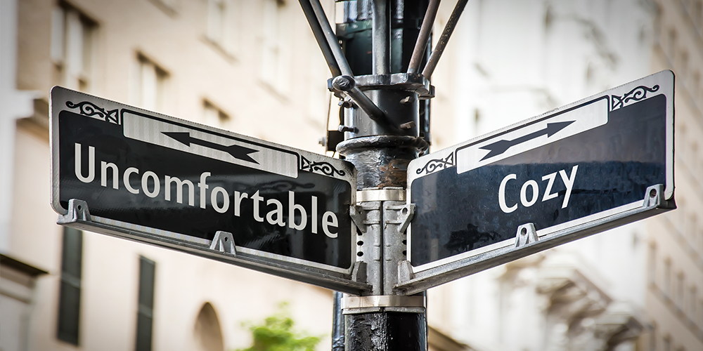 Like a whole-home humidifier, a street sign points from uncomfortable to cozy.