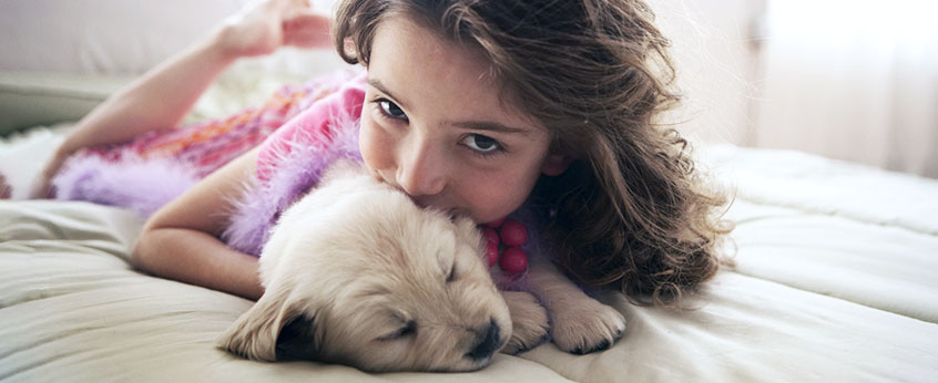 young girl with her pet puppy